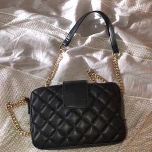 Small black and gold shoulder purse